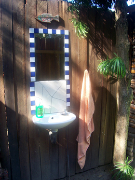 charming basin and mirror in the loo at Yellowwood Forest in Morgan Bay