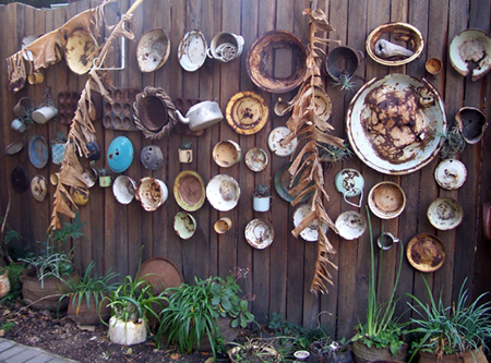 old enamel items as outdoor wall decorations
