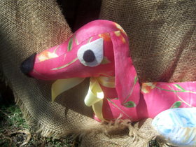 pink and yellow sausage dog draft excluder