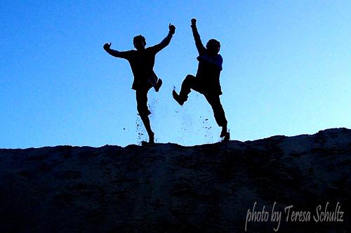 two boys having fun at the beach