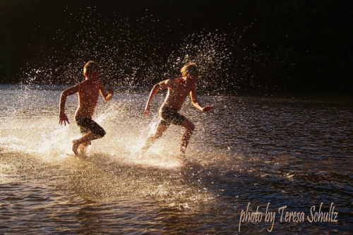 two boys running in Gonubie River