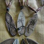 Wooden surfboard necklaces
