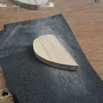 Flatting the flat surfaces to remove sanding marks left by the initial sanding