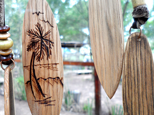 wooden surfboard necklaces at craft market