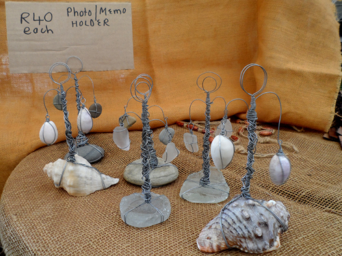 photo holders - or memo holders - made from wire, sea glass, beach pebbles and sea shells - Terry and Tony make and sell these 15cm tall photo holders for R40 each
