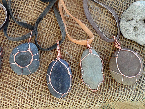 copper wire wrapped beach pebble necklaces sold by Terry and Tony for R30 each - on leather cord with a sliding knot for length adjustment